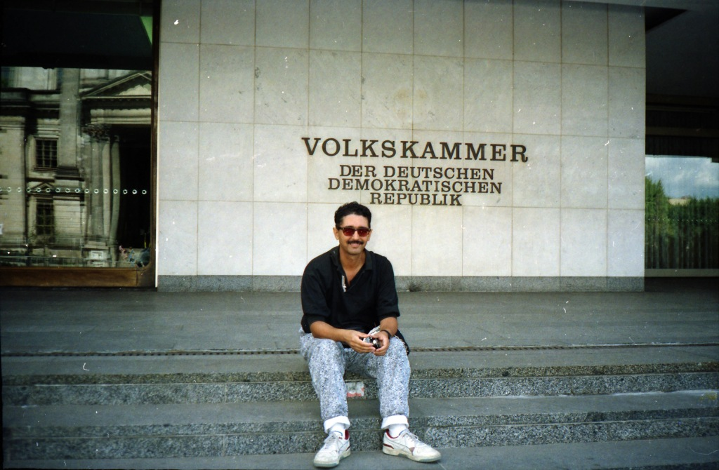This was a few months after the opening of the wall. Certainly not before, - I can't imagine sitting on the steps of the East German Parliament grinning luridly in my weird 1990s jeans. That just was not done.